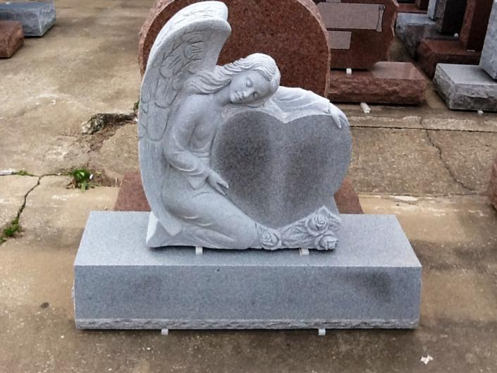 A beautiful monument that features a heart and angel to remember your loved one.